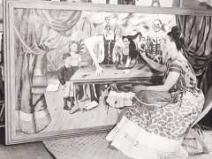 Frida with Painting 'Wounded Table'